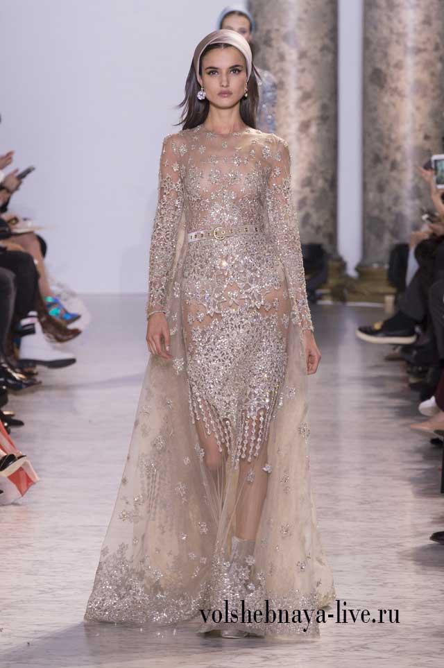 Изысканное вечерне платья усыпанное серебром и стазами