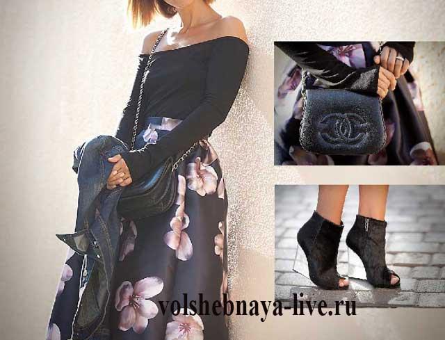 Блузка черного цвета с открытыми плечами и атласная юбка в цветах