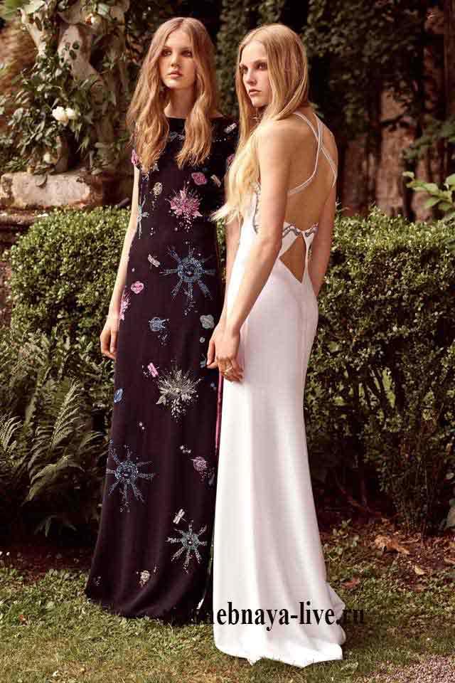 Вечерние платья черного и белого цвета с украшениями из стразов Roberto resort 2017