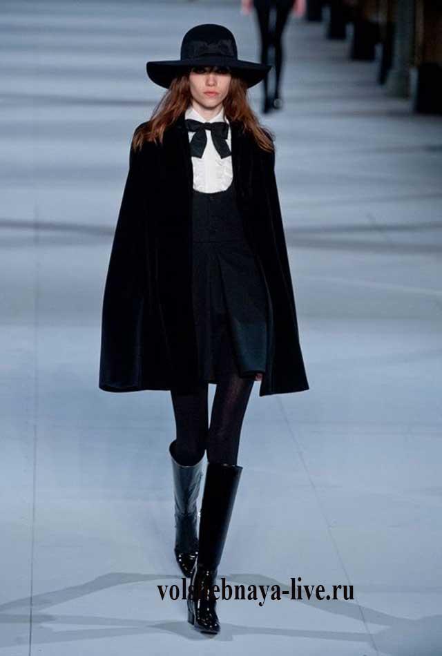Черное платье украшенное белы воротом