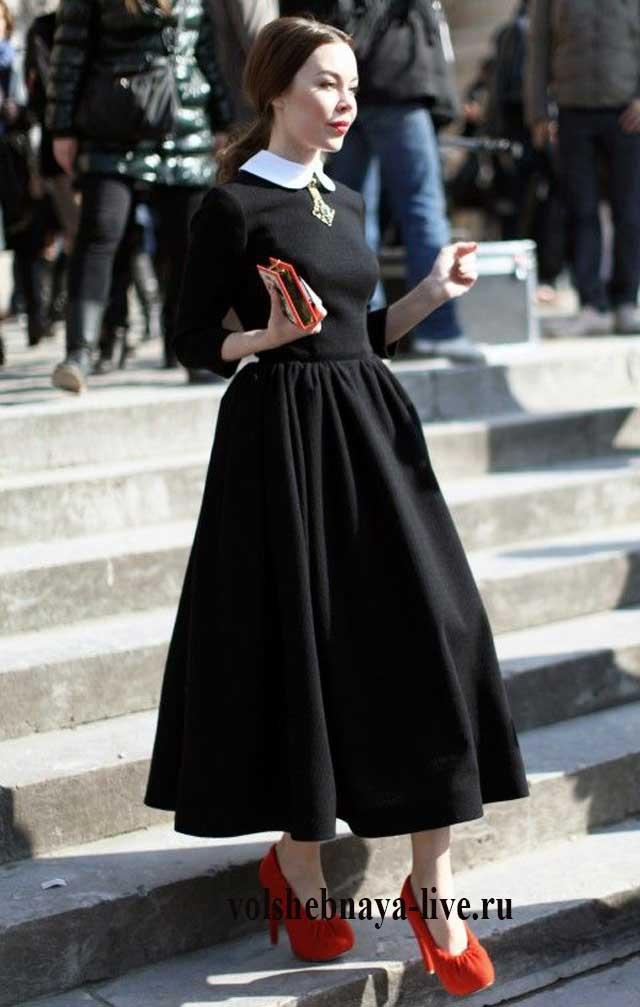 Ульяна Сергиенко в черном платье с воротником