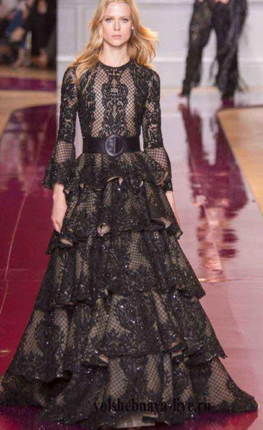 Черное платье из блестящей ткани с пышной юбкой в воланах