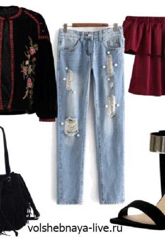 Рваные голубые джинсы сочетание с вышитым бомбером из велюра