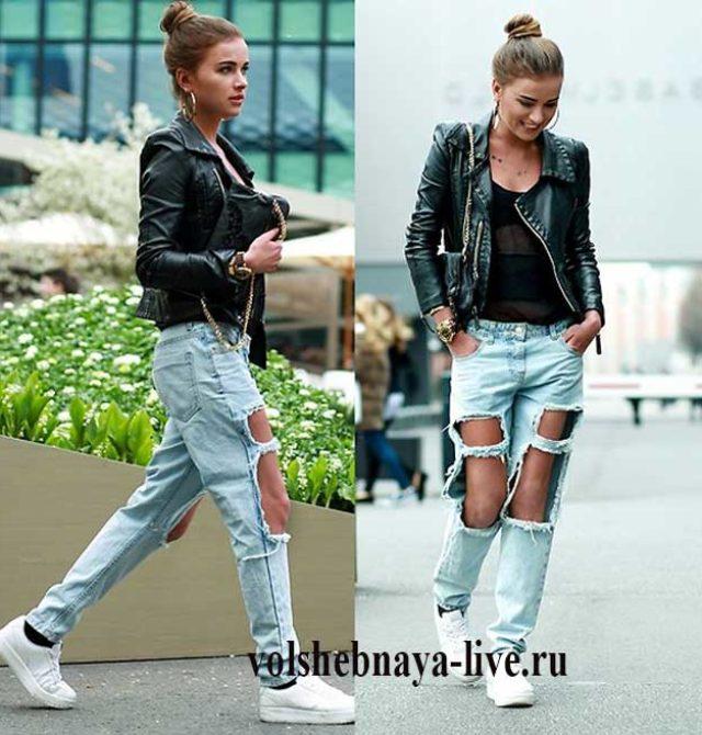 Рваные голубые джинсы с косухой черного цвета